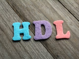 HDL (High-density lipoprotein) acronym on wooden background